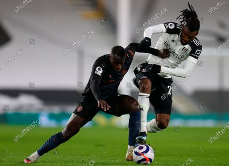 Manchester City's Benjamin Mendy (L) in action with Fulham's Andre-Frank Zambo Anguissa (R) during the English Premier League soccer match between Fulham FC and Manchester City in London, Britain, 13 March 2021.
