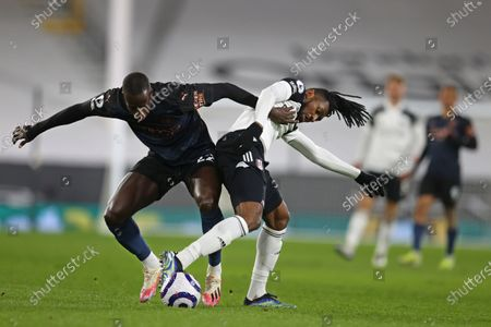 Stock Picture of Manchester City's Benjamin Mendy, left, challenges for the ball with Fulham's Andre-Frank Zambo Anguissa during an English Premier League soccer match between Fulham and Manchester City at the Craven Cottage stadium in London, England