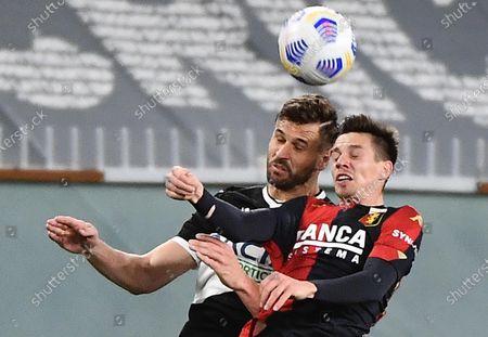 Stock Image of Genoa's Miha Zajc (R) and Udinese's Fernando Llorente (L) in action during the Italian Serie Serie A match Genoa CFC vs Udinese Calcio at Luigi Ferraris stadium in Genoa, Italy, 13 March 2021.