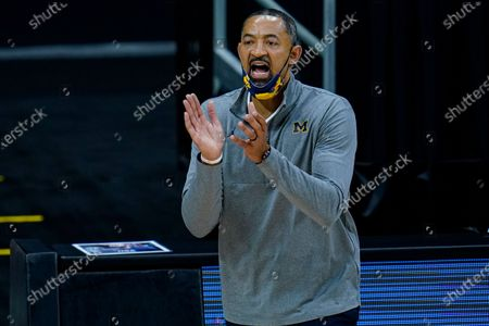 Michigan head coach Juwan Howard on the bench in the first half of an NCAA college basketball game against Ohio State at the Big Ten Conference tournament in Indianapolis