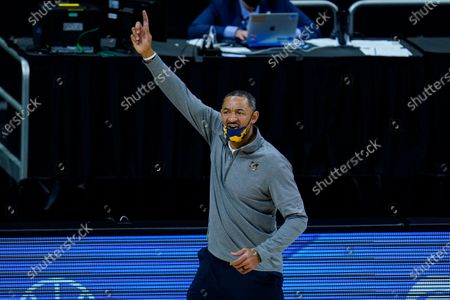Michigan head coach Juwan Howard questions a call in the second half of an NCAA college basketball game against Ohio State at the Big Ten Conference tournament in Indianapolis