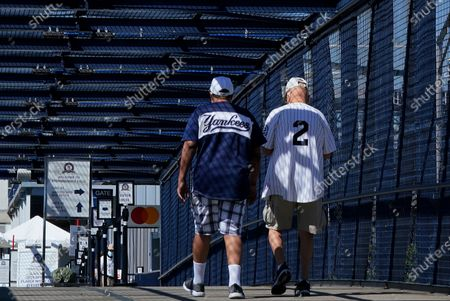 New York Yankees fans arrive at George M. Steinbrenner Field before a spring training exhibition baseball game between the Pittsburgh Pirates and the New York Yankees in Tampa, Fla