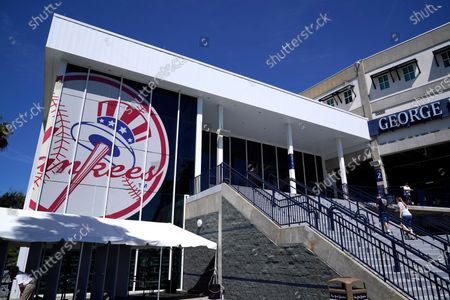 Fans arrive at George M. Steinbrenner Field for a spring training exhibition baseball game between the New York Yankees and the Pittsburgh Pirates in Tampa, Fla