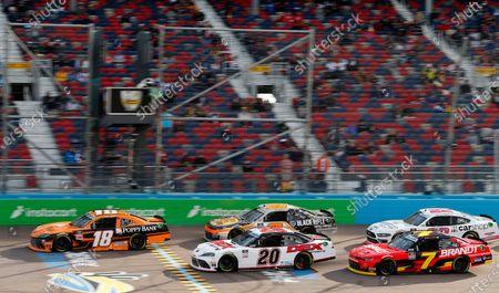 Daniel Hemric (18) leads Harrison Burton (20), Noah Gragson (9), Justin Allgaier (7) and Austin Cindric (22) on a restart during a NASCAR Xfinity Series auto race at Phoenix Raceway, in Avondale, Ariz