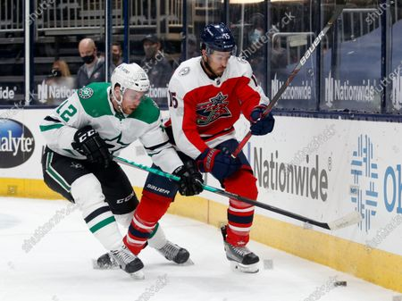 Dallas Stars forward Radek Faksa, left, chases the puck against Columbus Blue Jackets defenseman Michael Del Zotto during the first period of an NHL hockey game in Columbus, Ohio