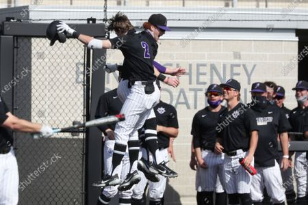 Stock Photo of Portland's Chad Stevens and Portland's Sam Brown jump up to celebrate Stevens' home run during an NCAA baseball game, in Portland, Ore