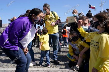 San Francisco Mayor London Breed, left, greets parents and students before speaking at a rally for San Francisco public schools to reopen during the coronavirus pandemic in San Francisco