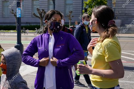 Mayor London Breed, left, speaks with Meredith Willa Dodson, co-founder of Decreasing the Distance, at a rally for San Francisco public schools to reopen during the coronavirus pandemic in San Francisco