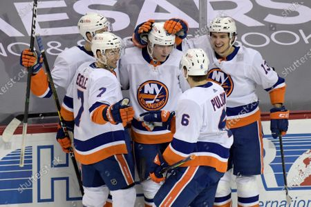 New York Islanders left wing Kieffer Bellows (20) celebrates his goal with defenseman Adam Pelech, left, right wing Jordan Eberle (7), defenseman Ryan Pulock (6) and center Mathew Barzal (13) during the third period of an NHL hockey game against the New Jersey Devils, in Newark, N.J. The Islanders defeated the Devils 3-2