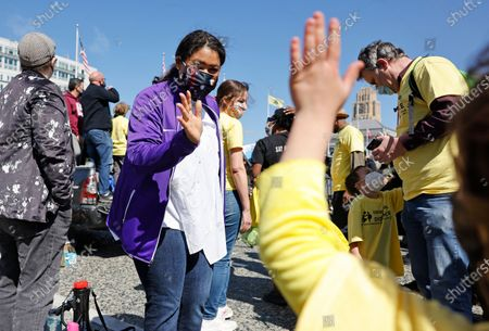 San Francisco Mayor London Breed waves to a young student before speaking to parents, students, teachers, and supporters at a rally in front of City Hall for San Francisco public schools to reopen during the one year anniversary of the city of San Francisco stay-at-home order during the start of the COVID-19 coronavirus pandemic in San Francisco, California, USA, 13 March 2021. San Francisco was the first US city to order a shelter-in-place order during the pandemic.