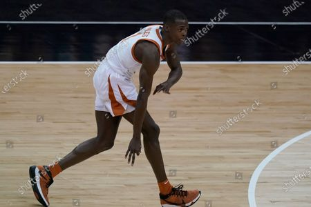 Stock Image of Texas's Andrew Jones celebrates after making a basket during the first half of an NCAA college basketball game against Oklahoma State in the championship of the Big 12 Conference tournament in Kansas City, Mo
