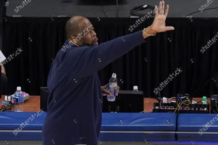Georgetown coach Patrick Ewing calls out to players during the second half of the team's NCAA college basketball game against Creighton for the championship of the Big East men's tournament, in New York. Georgetown won 73-48