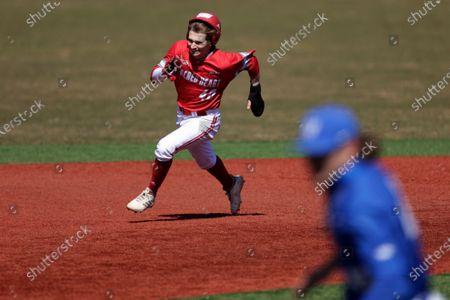 Sacred Heart pinch runner Mark Smith runs the bases against Hofstra during an NCAA baseball game, in Hempstead, N.Y