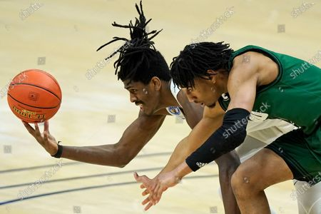Buffalo's Jeenathan Williams, left, and Ohio's Miles Brown battle for the ball during the second half of an NCAA college basketball game in the championship of the Mid-American Conference tournament, in Cleveland