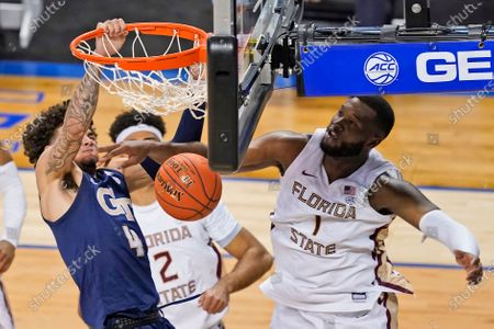 Georgia Tech guard Jordan Usher (4) dunks in front of Florida State forward RaiQuan Gray (1) during the second half of an NCAA college basketball Championship game of the Atlantic Coast Conference tournament in Greensboro, N.C