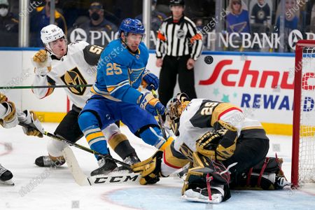 Vegas Golden Knights goaltender Marc-Andre Fleury (29) deflects a shot from St. Louis Blues' Jordan Kyrou (25) as Vegas Golden Knights' Dylan Coghlan (52) defends during the second period of an NHL hockey game, in St. Louis