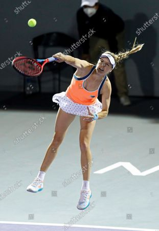 Canada's Eugenie Bouchard serves to Sara Sorribes Tormo, of Spain, during the women's final in the Abierto of Zapopan tennis tournament in Zapopan, Mexico