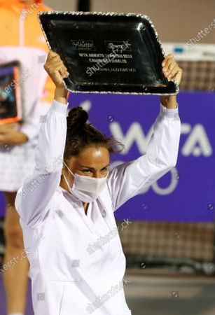 Stock Picture of Spain's Sara Sorribes celebrates with the trophy after winning in two sets 6 -2, 7-5, against Canada's Eugenie Bouchard during their final women's singles match in Abierto of Zapopan 2021 tennis tournament in Zapopan, Mexico