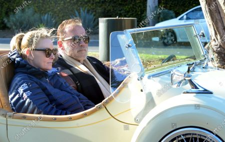 Stock Image of Exclusive - Arnold Schwarzenegger and Heather Milligan enjoy Saturday afternoon in a vintage Excalibur in Brentwood
