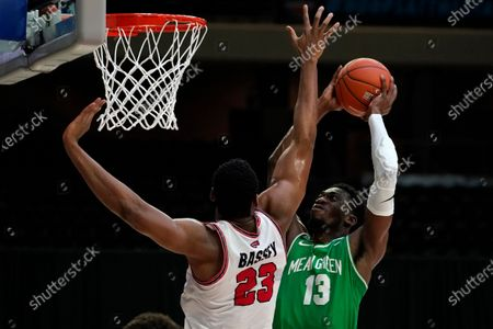 Western Kentucky center Charles Bassey (23) tries to block a shot by North Texas forward Thomas Bell (13) during the first half of the championship game in the NCAA Conference USA men's basketball tournament, in Frisco, Texas