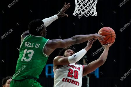 Western Kentucky guard Dayvion McKnight (20) shoots over North Texas forward Thomas Bell (13) during the second half of the championship game in the NCAA Conference USA men's basketball tournament, in Frisco, Texas