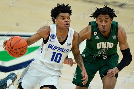 Buffalo's Ronaldo Segu (10) drivers past Ohio's Miles Brown (2) during the second half of an NCAA college basketball game in the championship of the Mid-American Conference tournament, in Cleveland