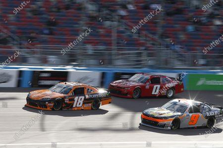 Stock Picture of Daniel Hemric (18), Noah Gragson (9) and Jeffrey Earnhardt (0) race through Turn 4 during a NASCAR Xfinity Series auto race at Phoenix Raceway, in Avondale, Ariz