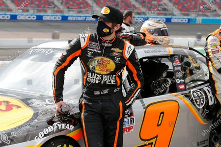 Noah Gragson stands with his race car on pit road prior to a NASCAR Xfinity Series auto race at Phoenix Raceway, in Avondale, Ariz. Gibbs finished second in the race