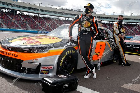 Stock Image of Noah Gragson, left, stands with his race car on pit road prior to a NASCAR Xfinity Series auto race at Phoenix Raceway, in Avondale, Ariz. Gibbs finished second in the race