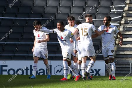 Cameron Jerome celebrates with team mates after scoring for Milton Keynes Dons, to take the lead making it 1 - 0 against Accrington Stanley, during the Sky Bet League 1 match between MK Dons and Accrington Stanley at Stadium MK, Milton Keynes on Saturday 13th March 2021. (Credit: John Cripps | MI News)