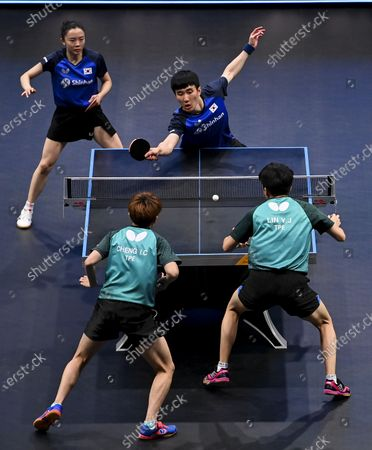 Lee Sangsu (top-R) and Jeon Jihee (top-L) of South Korea compete during the mixed doubles final between Lee Sangsu/Jeon Jihee of South Korea and Cheng I-Ching/Lin Yun-Ju of Chinese Taipei at WTT Star Contender Doha 2021 in Doha, Qatar, on March 13, 2021.