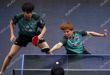 Cheng I-Ching (R) and Lin Yun-Ju of Chinese Taipei compete during the mixed doubles final between Lee Sangsu/Jeon Jihee of South Korea and Cheng I-Ching/Lin Yun-Ju of Chinese Taipei at WTT Star Contender Doha 2021 in Doha, Qatar, on March 13, 2021.