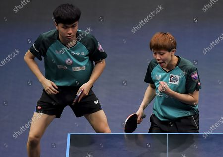Stock Image of Cheng I-Ching (R) and Lin Yun-Ju of Chinese Taipei react during the mixed doubles final between Lee Sangsu/Jeon Jihee of South Korea and Cheng I-Ching/Lin Yun-Ju of Chinese Taipei at WTT Star Contender Doha 2021 in Doha, Qatar, on March 13, 2021.