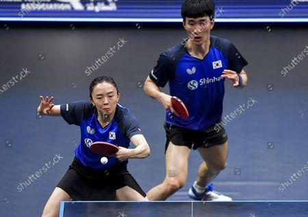 Lee Sangsu (R) and Jeon Jihee of South Korea compete during the mixed doubles final between Lee Sangsu/Jeon Jihee of South Korea and Cheng I-Ching/Lin Yun-Ju of Chinese Taipei at WTT Star Contender Doha 2021 in Doha, Qatar, on March 13, 2021.