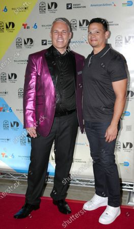 (l-R) Jaie Laplante and Jose Navas walk the red carpet at the Miami Dade College's 38th annual Miami film festival closing night with the film Birthright at the Silverspot Cinema