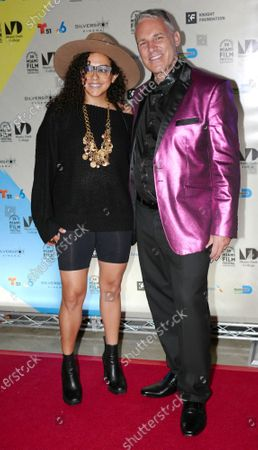 Maria Betania-Fernandez and Jaie Laplante walk the red carpet at the Miami Dade College's 38th annual Miami film festival closing night with the film Birthright at the Silverspot Cinema