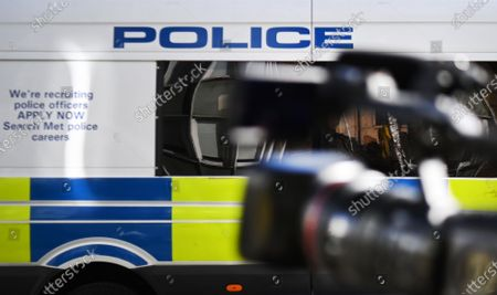 Stock Photo of A news camera stands in front of a police van in London, Britain, 14 March 2021. Public anger is increasing following a number of arrests of women at the Reclaim These Streets vigil for Sarah Everard that has officially been cancelled in London at Clapham Common, on 13 March. Metropolitan Police claims that shutting down the vigil was 'necessary' because of the 'overriding need to protect people's safety.' British Home Office minister Victoria Atkins reportedly has demanded a report on the police crackdown of the vigil. Serving police constable Wayne Couzens, 48, had appeared in court charged with the kidnapping and the killing of Sarah Everard who went missing 03 March while walking home from a friend's flat in south London.