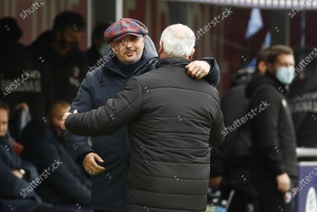 Bologna's coach Sinisa Mihajlovic (L) and Sampdoria's coach Claudio Ranieri greet each other prior to the Italian Serie A soccer match Bologna FC vs UC Sampdoria at Renato Dall'Ara stadium, Italy, 14 March 2021.