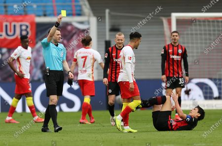 Justin Kluivert of RB Leipzig is shown a yellow card by Match Referee, Felix Zwayer after a foul on Makoto Hasebe of Eintracht Frankfurt  during the Bundesliga match between RB Leipzig and Eintracht Frankfurt at Red Bull Arena in Leipzig, Germany, 14 March 2021.