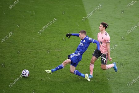 Leicester's Jamie Vardy (L) and Sheffield's Ethan Ampadu (R) in action during the English Premier League soccer match between Leicester City and Sheffield United in Leicester, Britain, 14 March 2021.
