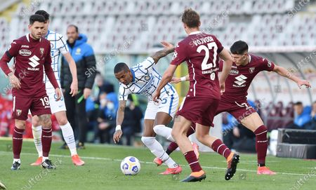 Torino's Sasa Lukic (R) and Inter's Ashley Young (C) in action during the Italian Serie A soccer match Torino FC vs FC Inter at the Olimpico Grande Torino stadium in Turin, Italy, 14 March 2021.