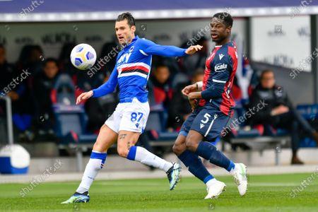 Antonio Candreva (UC Sampdoria) and iAdama Soumaoro (Bologna FC) n action