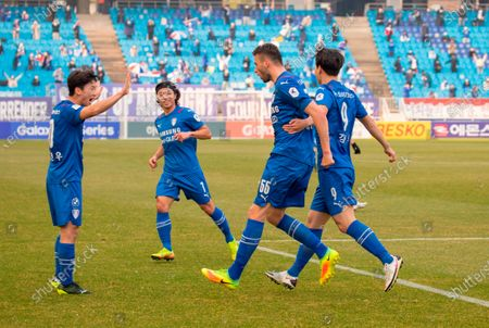 Stock Picture of (L-R) Kim Min-Woo, Ko Seung-Beom, Uros Deric, Kim Gun-Hee (Suwon Samsung Bluewings FC) - Football / Soccer : Serbian Uros Deric of Suwon Samsung Bluewings FC celebrates after scoring a goal during the 4th round of the 2021 K League 1 soccer match between Suwon Samsung Bluewings FC 1:1 Gangwon FC at the Suwon World Cup Stadium in Suwon, south of Seoul, South Korea.