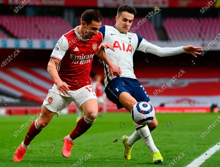 Arsenal's Cedric Soares (L) in action against Tottenham's Sergio Reguilon (R) during the English Premier League soccer match between Arsenal FC and Tottenham Hotspur in London, Britain, 14 March 2021.