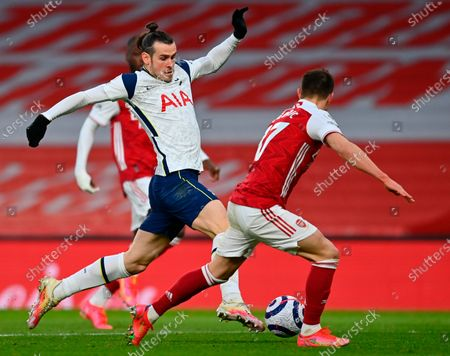Tottenham's Gareth Bale (L) in action against Arsenal's Cedric Soares (R) during the English Premier League soccer match between Arsenal FC and Tottenham Hotspur in London, Britain, 14 March 2021.