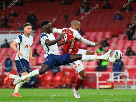 Arsenal's Alexandre Lacazette (R) in action against Tottenham's Davinson Sanchez (C) during the English Premier League soccer match between Arsenal FC and Tottenham Hotspur in London, Britain, 14 March 2021.