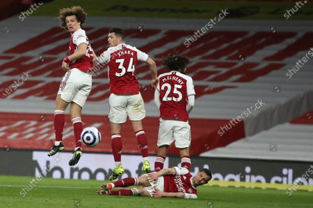 Arsenal's Cedric Soares (bottom) and teammates in action during the English Premier League soccer match between Arsenal FC and Tottenham Hotspur in London, Britain, 14 March 2021.