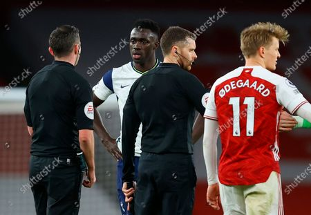 Tottenham's Davinson Sanchez (2-L) talks to referee Michael Oliver (L) after the English Premier League soccer match between Arsenal FC and Tottenham Hotspur in London, Britain, 14 March 2021.