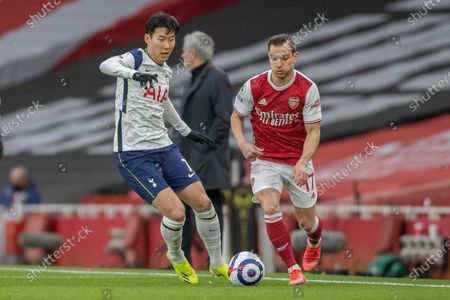 Heung-Min Son of Tottenham Hotspur and Cedric Soares of Arsenal in action