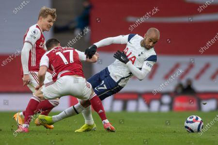 Cedric Soares of Arsenal fouls Lucas Moura of Tottenham Hotspur
